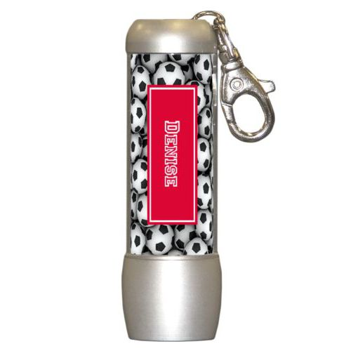 Personalized flashlight personalized with soccer balls pattern and name in bright red