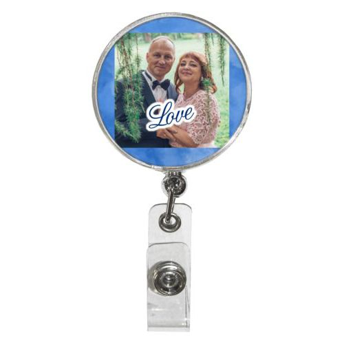 "Personalized badge reel personalized with blue cloud pattern and photo and the saying ""love"""