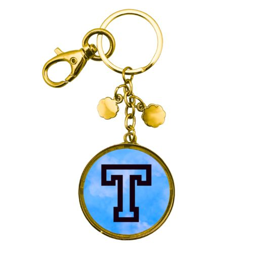 "Personalized metal keychain personalized with light blue cloud pattern and the saying ""T"""
