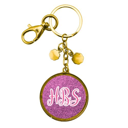 "Personalized keychain personalized with light pink glitter pattern and the saying ""HBS"""