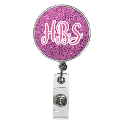 "Personalized badge reel personalized with light pink glitter pattern and the saying ""HBS"""