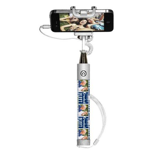 "Personalized selfie stick personalized with a photo and the saying ""World's Greatest Poppy"" in navy blue and white"