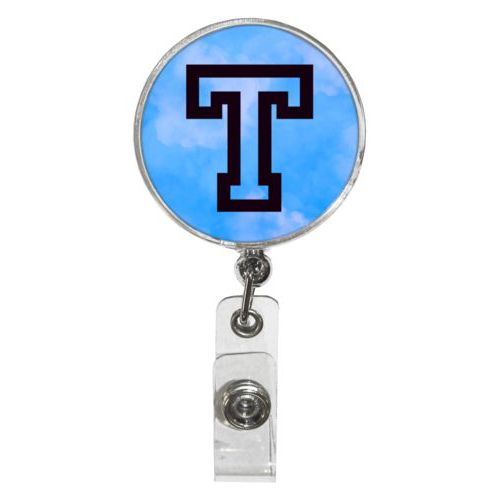 "Personalized badge reel personalized with light blue cloud pattern and the saying ""T"""
