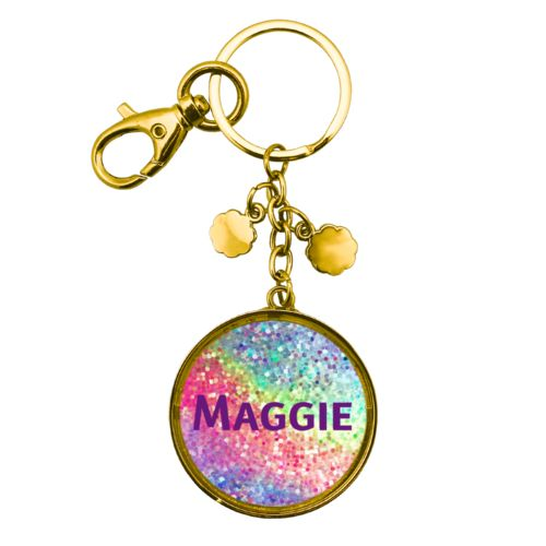"Personalized metal keychain personalized with glitter pattern and the saying ""Maggie"""