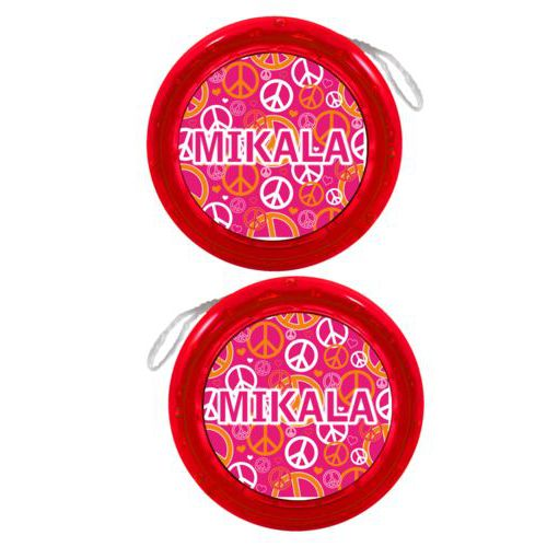 "Personalized yoyo personalized with peace out pattern and the saying ""MIKALA"""